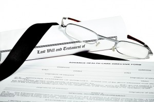 Will and Testament with Glasses Pen and Income Tax Return