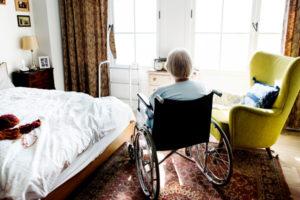 Elder abuse concept: Elderly woman in wheelchair